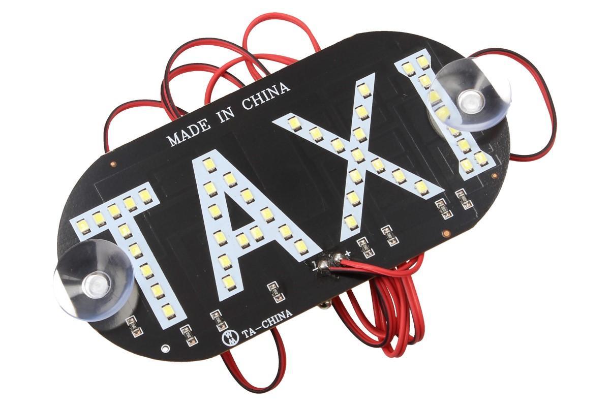 Foto 1 - LED světelná značka taxi 14 x 7 cm je placatá, oválná deska, která obsahuje 45 LED diod v podobě nápisu TAXI. Tato světelná LED značka je vhodná nejen pro řidiče taxi služby, ale i pro obdivovatele těchto aut.
